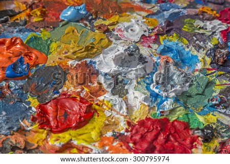 Briefly stored painter's palette - tools of a painter - stock photo