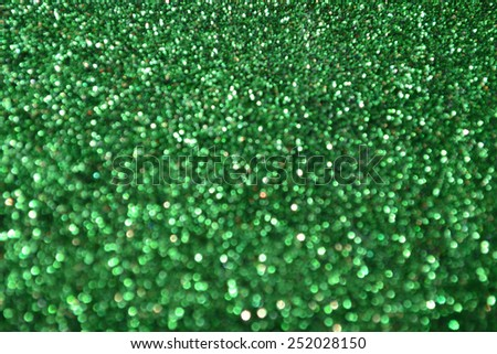 Bright and abstract blurred green background with shimmering glitter - stock photo