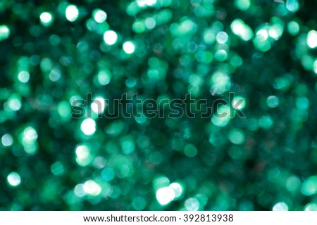 Bright and abstract blurred sea blue and green background with shimmering glitter - stock photo