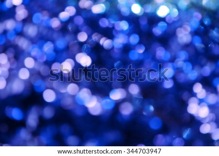 Bright and abstract blurred sea blue background with shimmering glitter