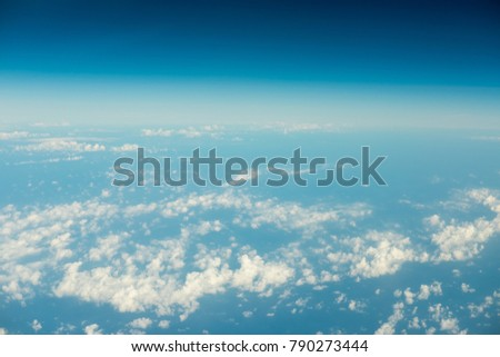 Bright and beautiful blue sky with white clouds with space for horizon nature concept background.