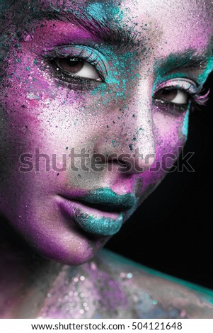 bright and beautiful makeup on a beautiful brunette, art in photography