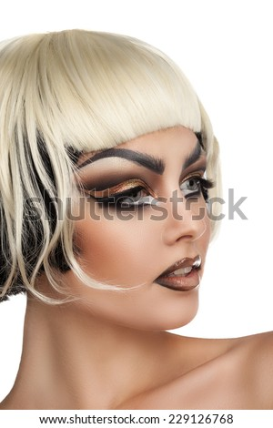bright and beautiful young brunette woman with make up and white bangs - stock photo