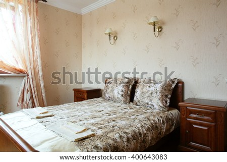 bright and brand new interior of european bedroom
