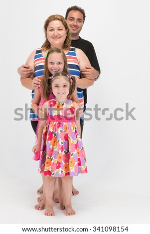 Bright and clean shot of family lined up nicely all together - stock photo