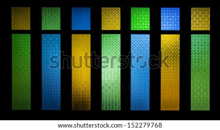 bright and colorful texture from stain glass door - stock photo