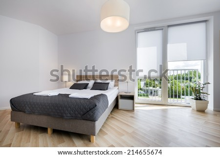 Bright and comfortable bedroom interior design in scandinavian style - stock photo
