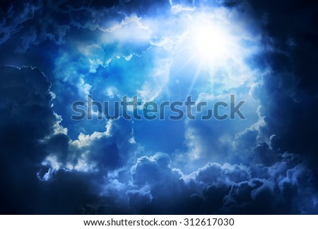 Bright and dark clouds with sun ,on the heaven. - stock photo