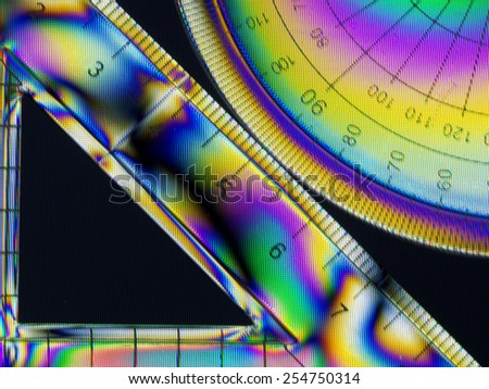 Bright and fun. School geometry equipment with rainbow patterns. Set square, protractor. - stock photo