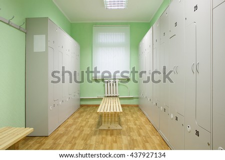 bright and modern dressing room in gym - stock photo
