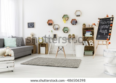 Bright and spacious child room with interesting recycling furniture