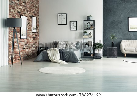Bright Apartment With Walls In Shades Of Grey And One Decorative Brick Wall