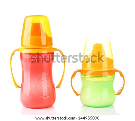 Bright baby bottles with milk isolated on white - stock photo