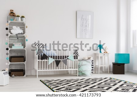 Bright baby room in scandinavian style with blue accessories