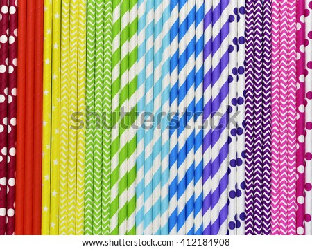Bright background of colorful paper straws in rainbow colors. - stock photo