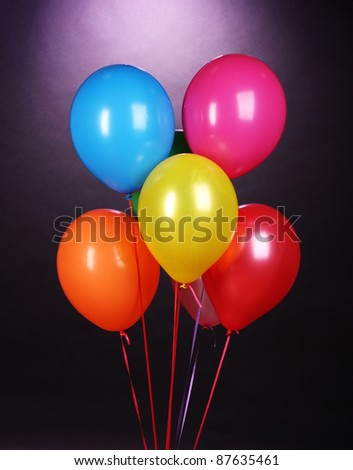 bright balloons on purole background