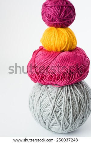 Bright balls of yarn lying on a white background