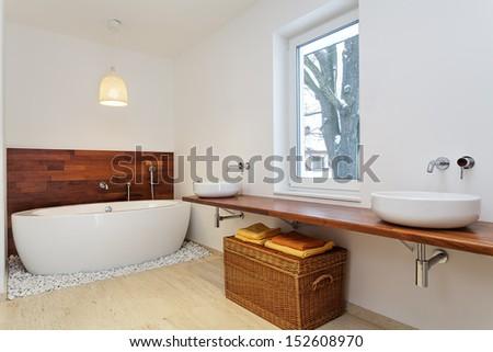 Bright bathroom with big window - stock photo