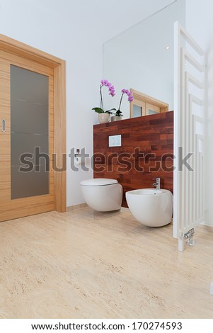 Bright bathroom with orchid and mirror