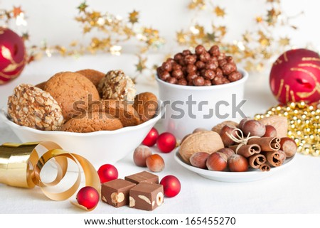 Bright baubles and assorted sweet treats - stock photo