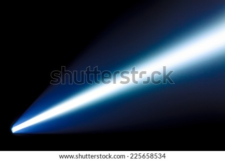 Bright beam from the  power flashlight in the dark - stock photo