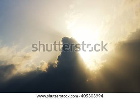 Bright beams of a sunlight because of clouds - stock photo