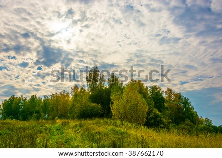 Bright beautiful autumn landscape backlit in the Central part of Russia.  - stock photo