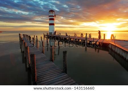 Bright beautiful sea sunset panorama above the beacon tower - stock photo