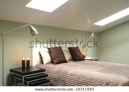 bright bedroom in the attic - stock photo