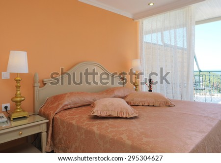 bright bedroom interior in a luxury house, hotel.