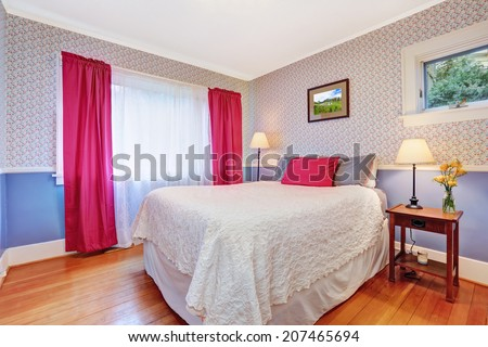 Bright bedroom interior in soft lavender color. Pink curtains blend perfectly with pink and grey pillows