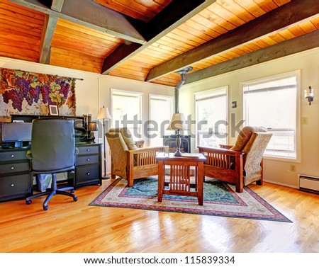 Bright Bedroom with red bed, open balcony door and beige walls. Simple American farm house interior. - stock photo