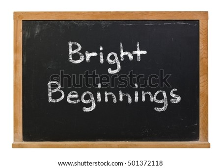 Bright Beginnings written in white chalk on a black chalkboard isolated on white