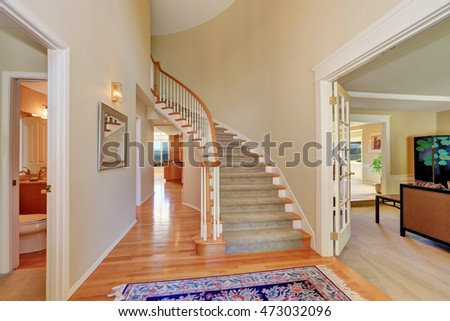 Bright Beige Hallway Interior With Carpet Staircase In Large Luxury House.  Northwest, USA