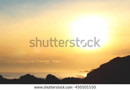 Bright big sun above the ocean, Mornington Peninsula, Sorrento beach, Victoria, Australia - stock photo