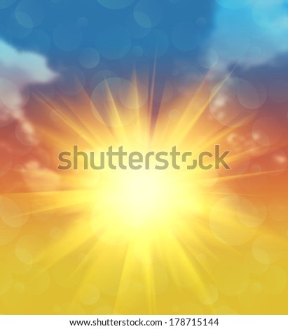 Bright big sun at sunset in the sky background. - stock photo