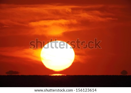 Bright big sun on the sky with clouds - stock photo