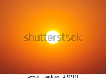 Bright big sun on the sky with yellow orange gradient colors - stock photo