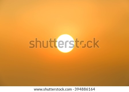 Bright big sun on the sky with yellow orange gradient colors - stock photo