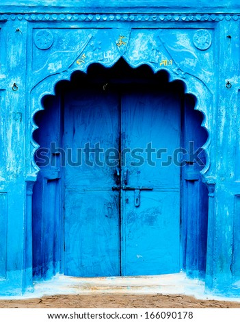 Bright blue doorway in India - stock photo