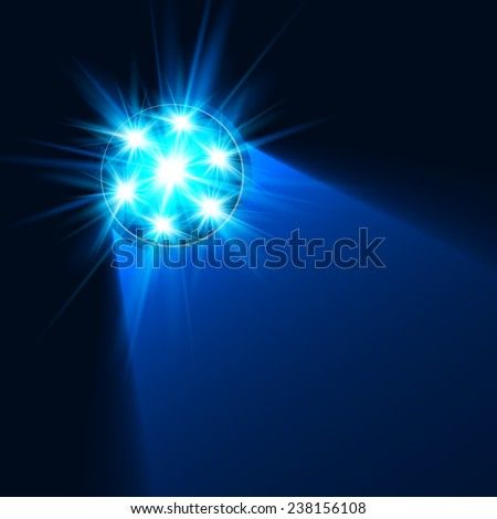 Bright blue flashlight light in darkness - stock photo