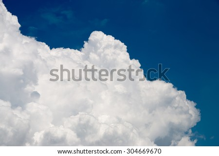 Bright blue sky with fluffy white clouds  - stock photo