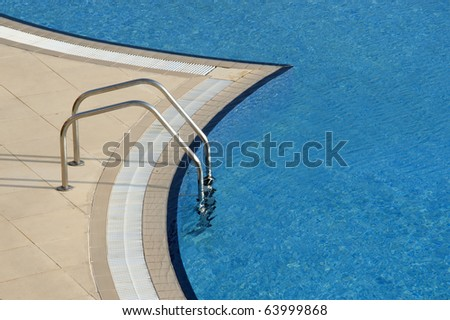 bright blue swimming pool with steps