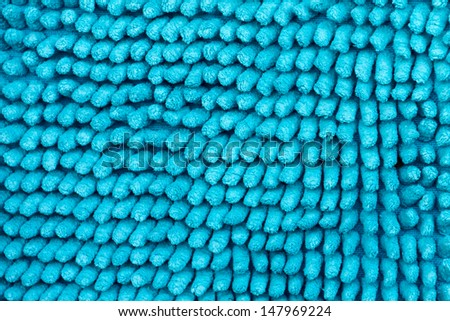 Bright blue texture, the basis is the deep-piled carpet close-up.