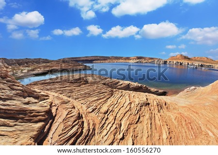 Bright blue water bay. Bottling magnificent Lake Powell photographed by Fisheye lens - stock photo