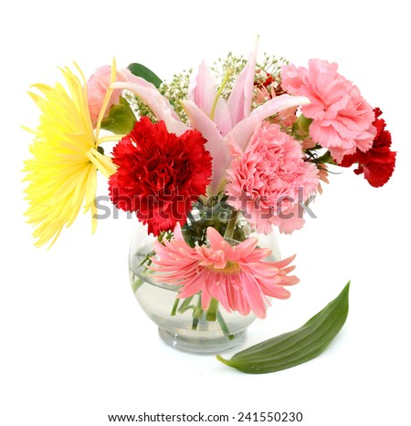 Bright bouquet in crystal vase isolated on white background - stock photo