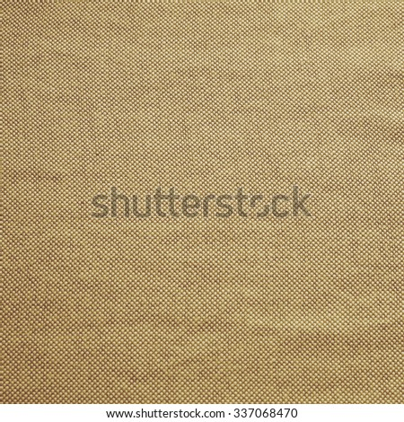 bright brown caramel coffee colored of burlap cotton fabrics background pattern:textile edge linen clothing pattern wallpaper backdrop texture.picture in square backdrop.