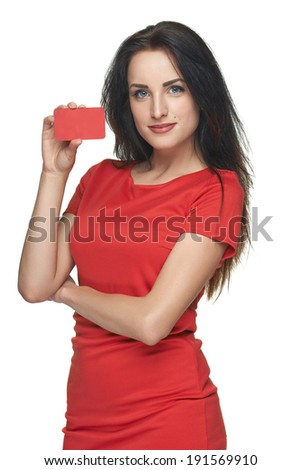 Bright business woman showing blank business card or credit card, over white background - stock photo