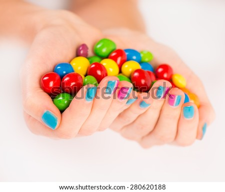 Bright candies in woman's hands