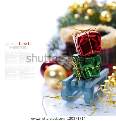 Bright christmas composition with sledge (with easy removable sample text) - stock photo